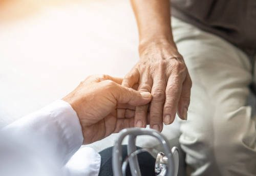Parkinson's disease patient, Arthritis hand pain or mental health care concept with geriatric doctor consulting examining elderly senior aged adult in medical exam clinic or hospital